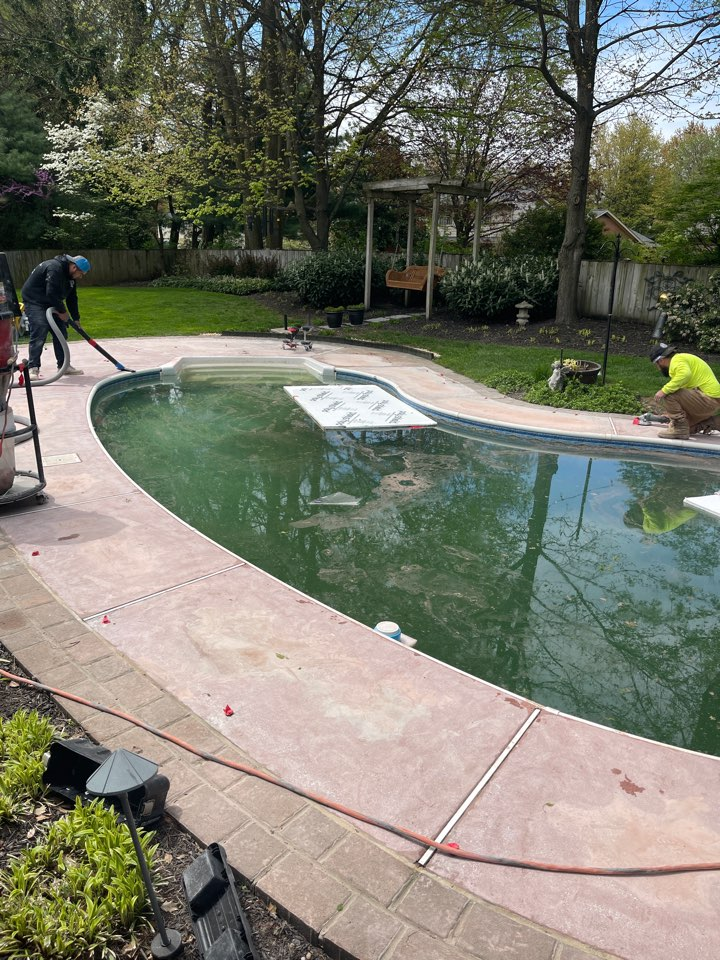 The team is prepping this pool deck for Graniflex resurfacing. Near Frederick Maryland.