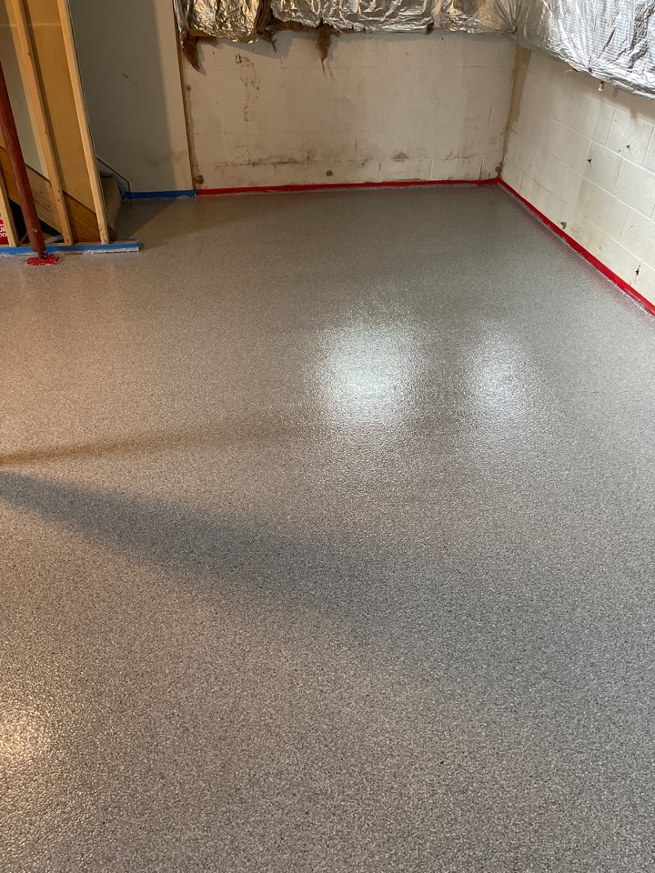 Our team just finished resurfacing this basement floor with Graniflex. Near Ranson West Virginia.