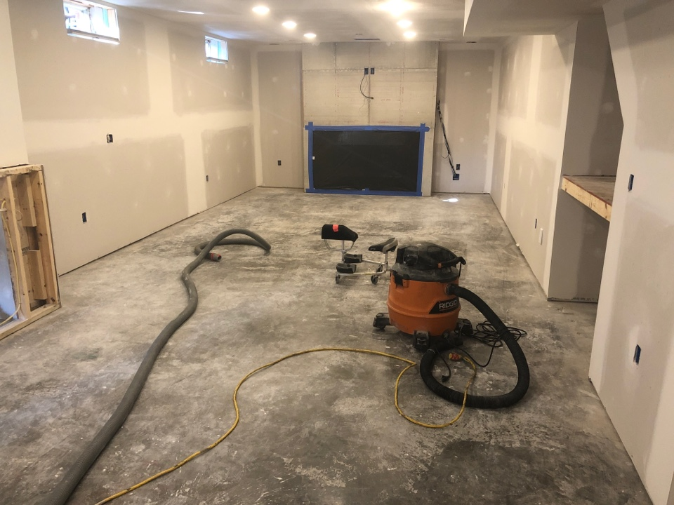 We are giving this concrete basement floor a marble metallic coating. Right now, the team is doing an initial grind and work area prep. Near Front Royal Virginia.