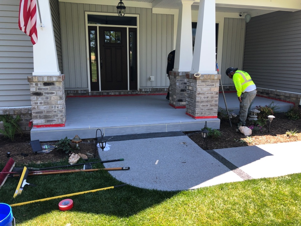 The team is Sanding & taping off the design before the Rustic Concrete Wood overlay gets finished. Near Warrenton Virginia