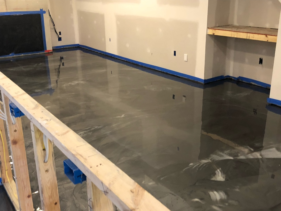 We are putting down a decorative marble coating on this concrete floor. It is made from three colors applied together with artistry. Near Front Royal Virginia.