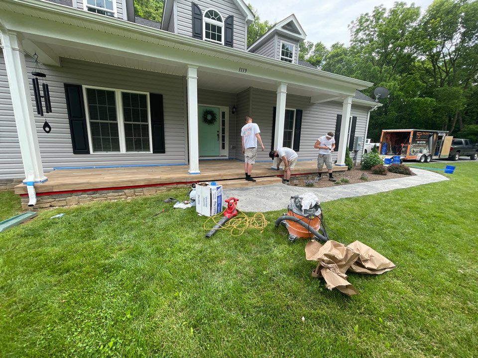 Winchester, VA - The team is staining the porch and walkway prior to applying acrylic sealer. Near Winchester Virginia.