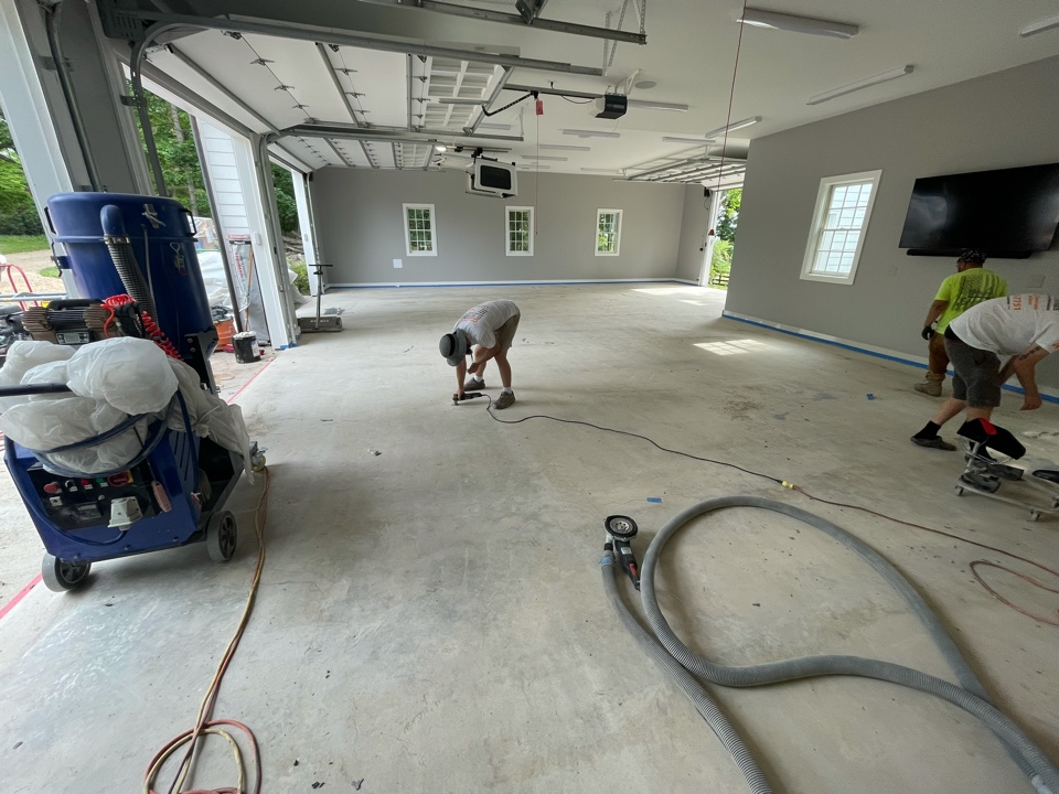 We are finishing up applying quick patch and cleaning up the surface before putting on the first coat to this concrete garage floor. Near Purcellville Virginia.