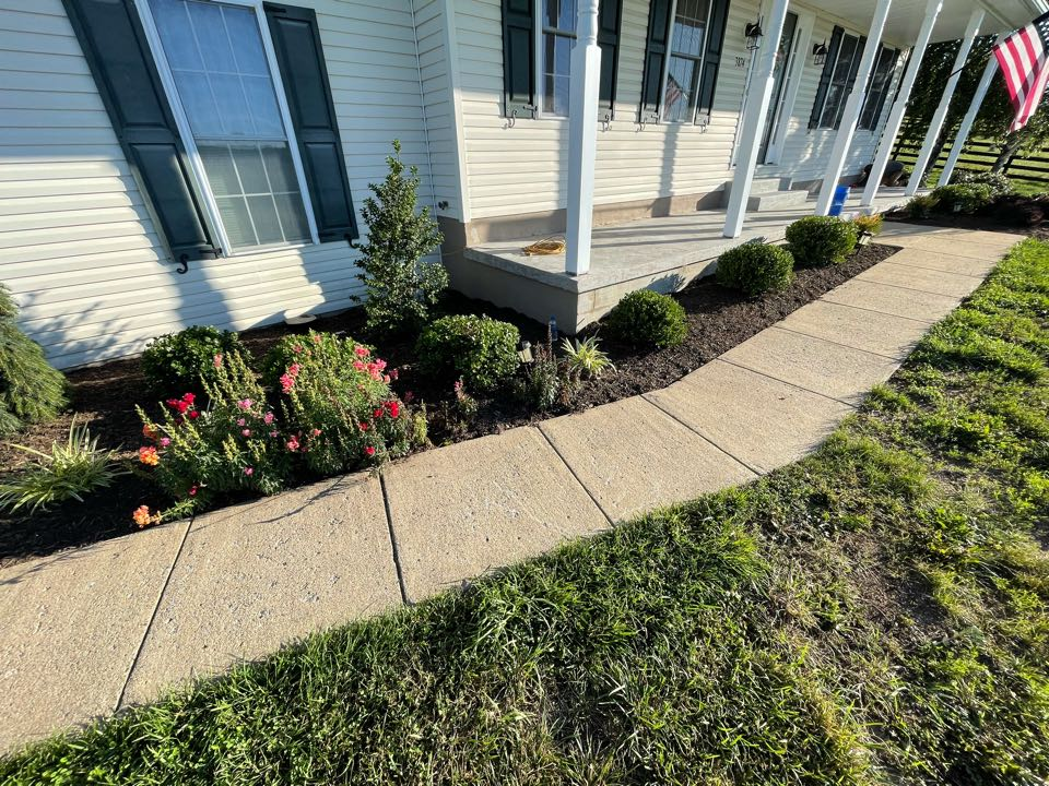 Winchester, VA - The team will tape off the work surface area then proceed to apply the base coat to the sidewalk and front porch. Near Winchester Virginia.