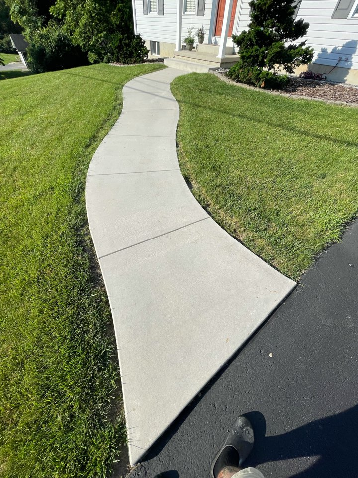 Martinsburg, WV - The team is about to Power wash and acid etch this concrete sidewalk.  Near Martinsburg West Virginia