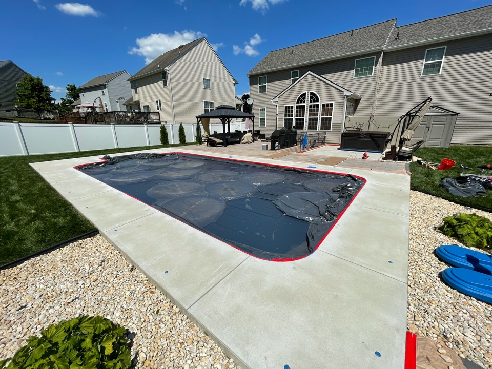 Charles Town, WV - The team is about to Tape off the pool deck and then apply base coating. Near Charles Town West Virginia