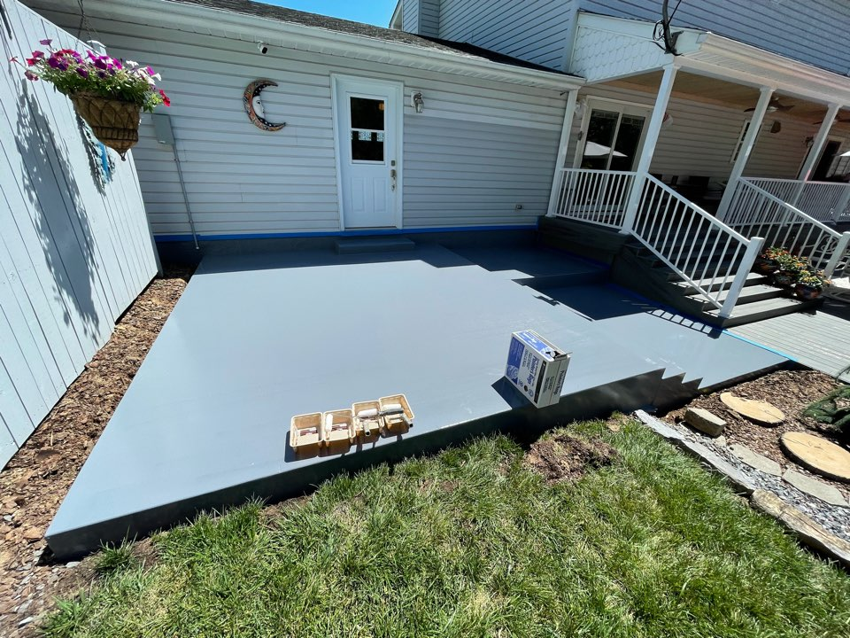 Martinsburg, WV - The team is not applying the Broadcast cost and flake application for the concrete coating. Near Martinsburg West Virginia