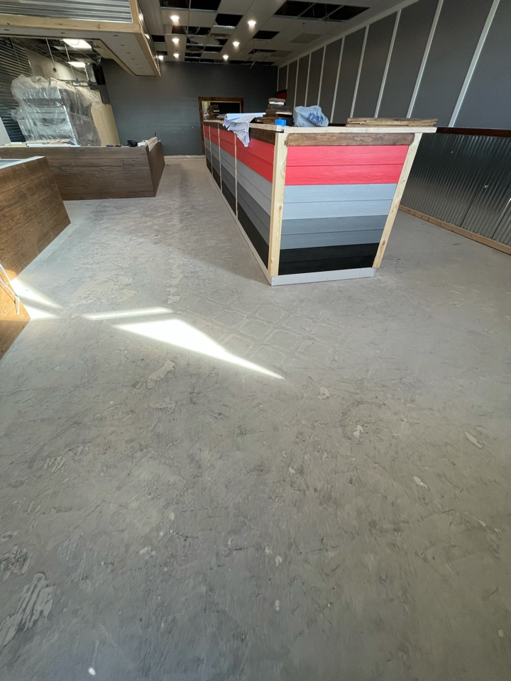 Winchester, VA - Today the team is prepping and grinding this concrete floor before putting on a new concrete coating. Near Winchester Virginia.