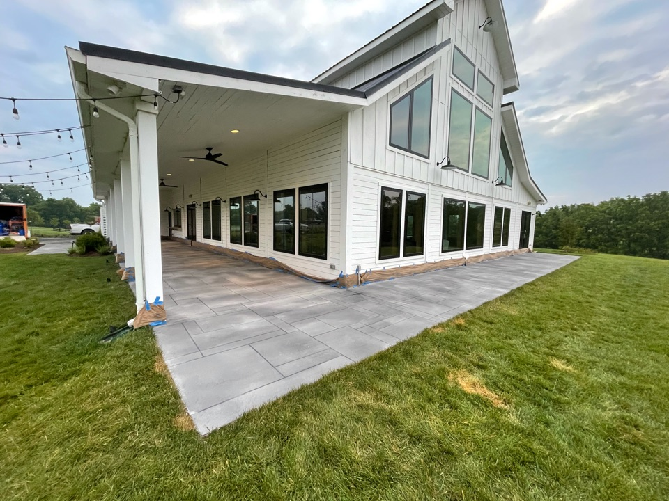 The team will apply sealer, pull up protective tape, and the concrete resurfacing job will be complete. Near Leesburg Virginia.