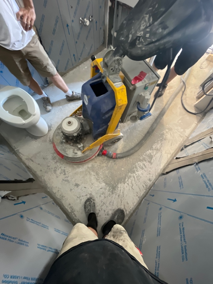 the team is prepping the concrete Bathroom floor in glass studio. Near Wardensville West Virginia