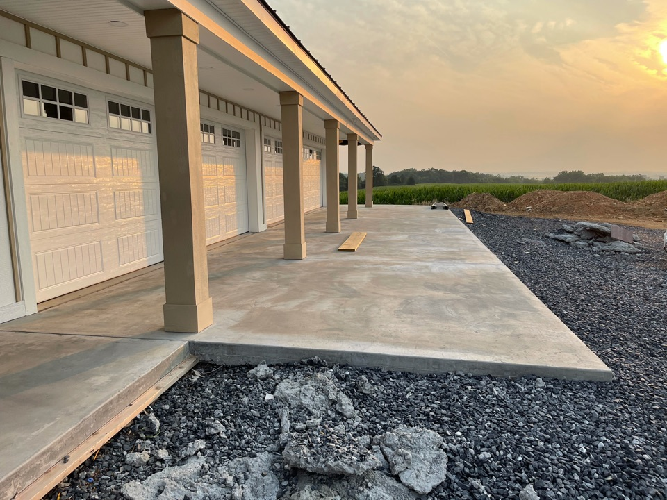 The team will apply a basecoat to this decorative concrete project. Near Strasburg Virginia.