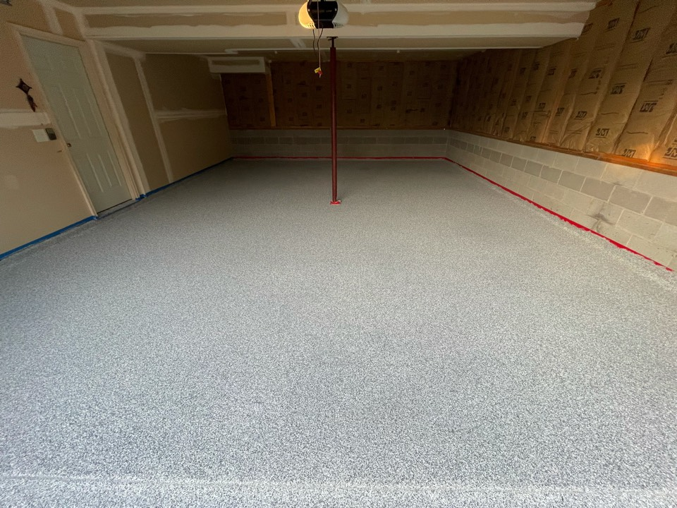 Martinsburg, WV - The team is cleaning up excess flake and applying sealer to this concrete garage floor. Near Martinsburg West Virginia.