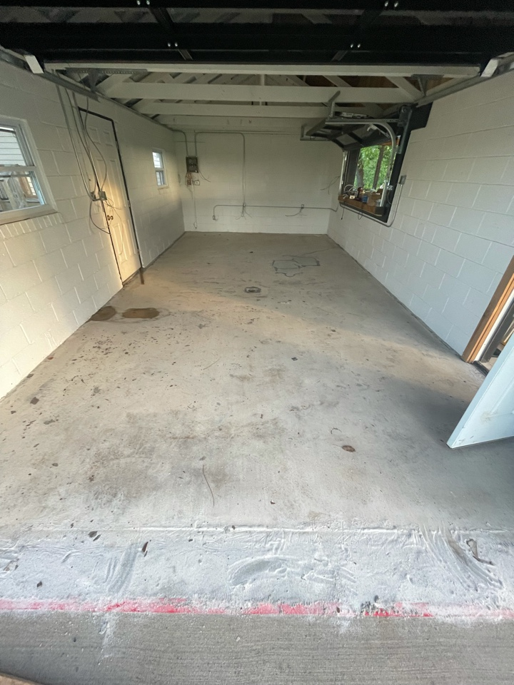 The team is about to grind down the surface, repair the concrete, and apply the basecoat. Near Midland Virginia.