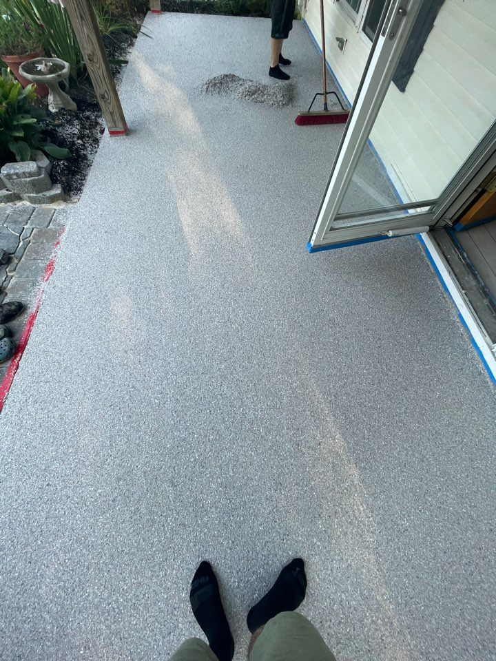 We are collecting the excess flake and preparing for sealer on this concrete patio. Near Winchester Virginia.