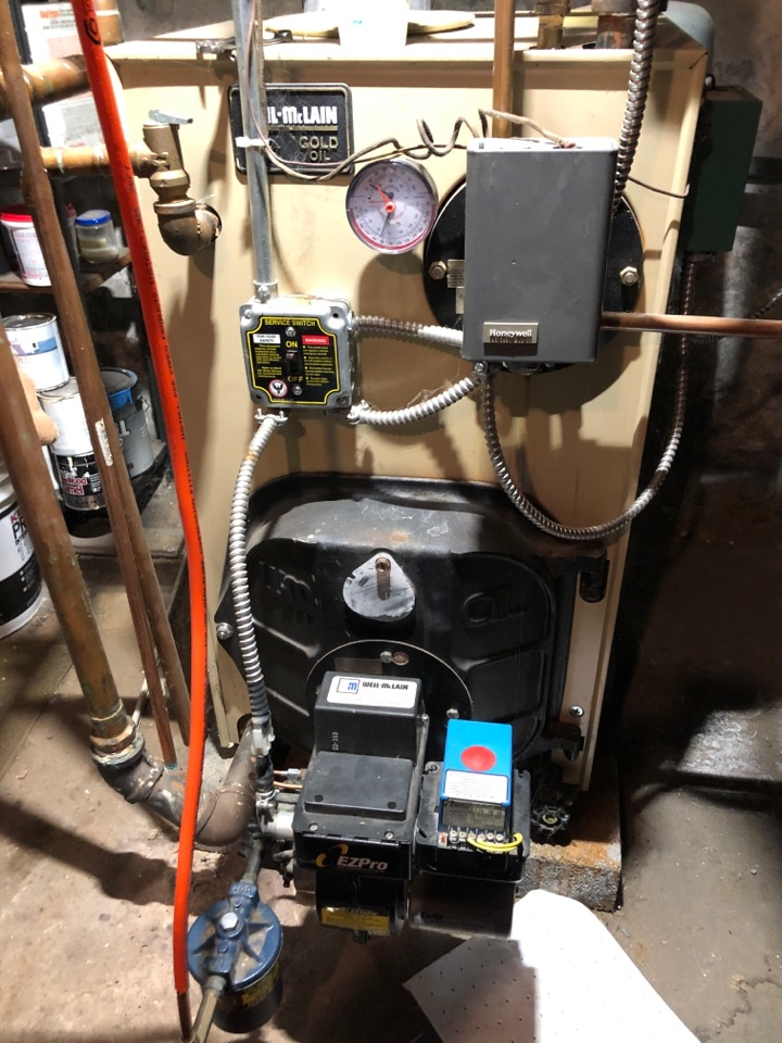 Newington, CT - Performing annual maintenance on Weil McLain oil boiler.