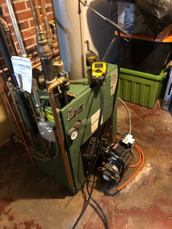 New Britain, CT - Performing annual maintenance on New Yorker oil boiler. Replacing oil filter due to oil leak and replacing hyvent.