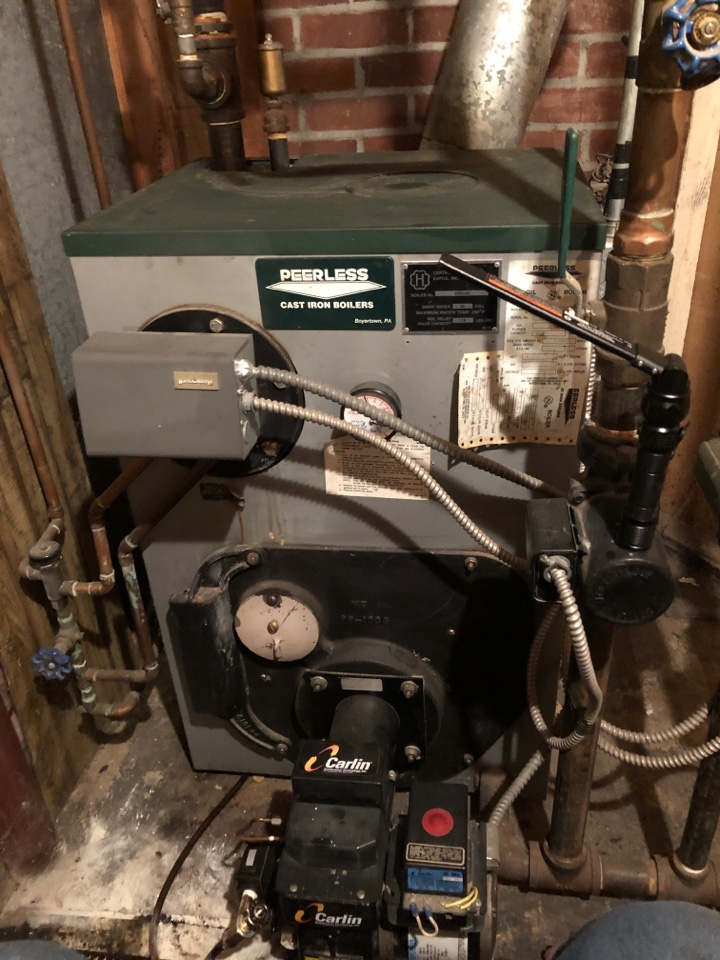 New Britain, CT - Performing annual maintenance on Peerless oil boiler.