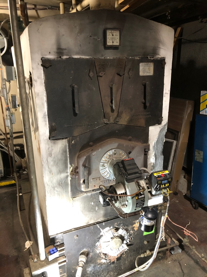 Bristol, CT - Performing annual maintenance on oil boiler.