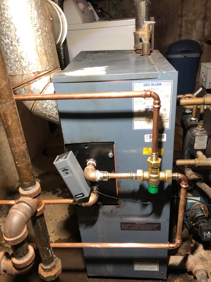 Newington, CT - Replacing tankless coil on Weil McLain steam boiler.