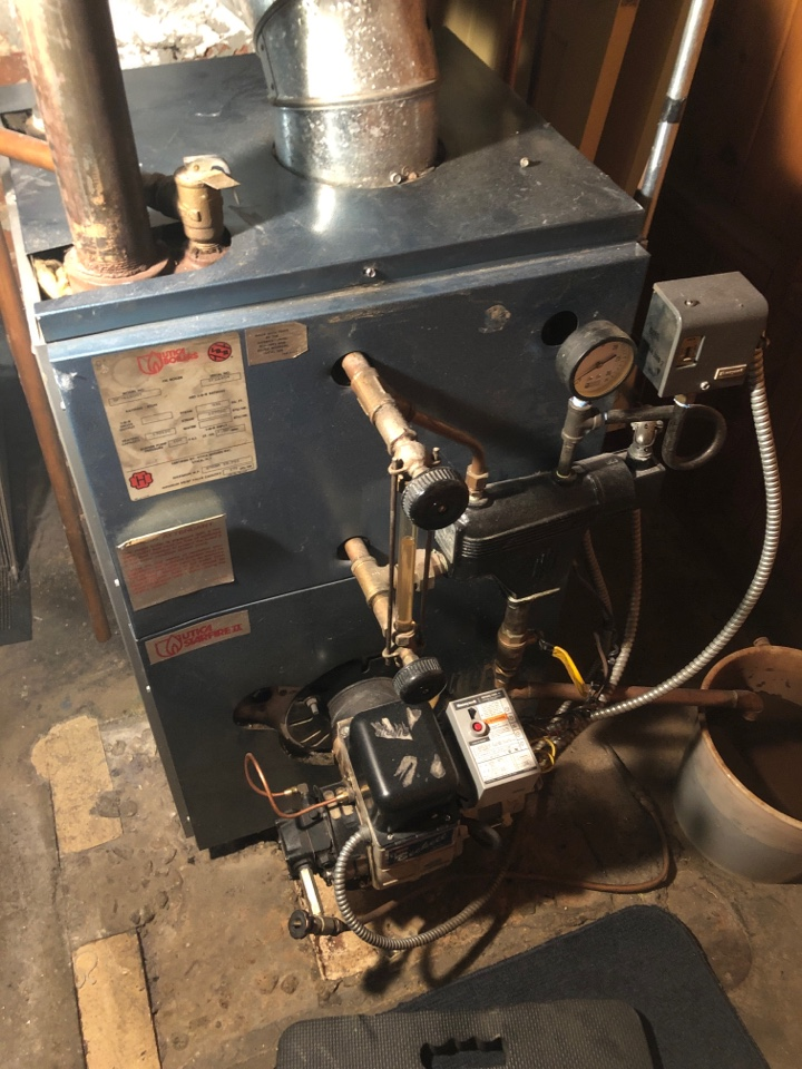 Newington, CT - Performing annual maintenance on Utica steam oil boiler.