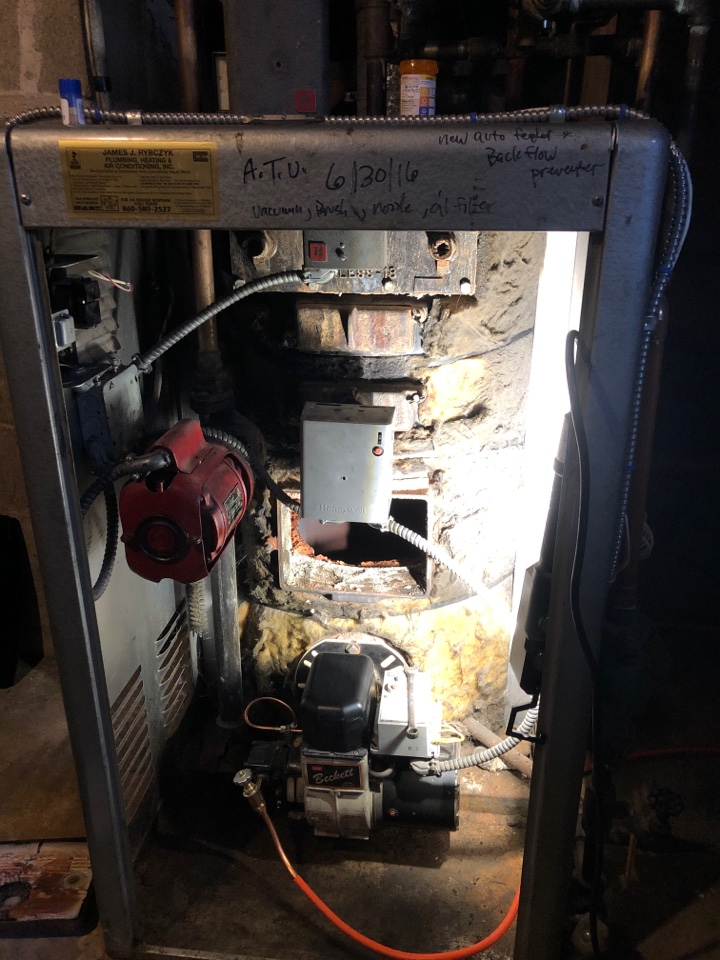 Plainville, CT - Performing annual maintenance on old peerless boiler with a Beckett oil burner.