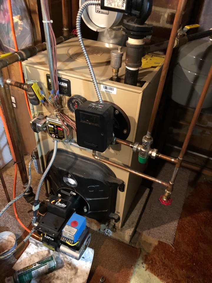Performing annual maintenance on Weil McLain oil fired boiler with Carlin EZ burner.
