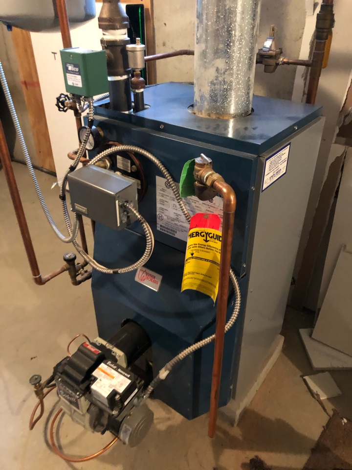 Performing annual maintenance on Utica oil fired boiler with Beckett burner.