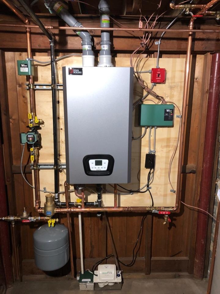 Berlin, CT - Installing high efficiency natural gas Utica MAH boiler.