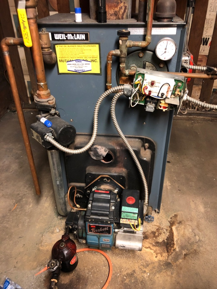 West Hartford, CT - Performing annual maintenance on Weil McLain oil boiler with Beckett burner.