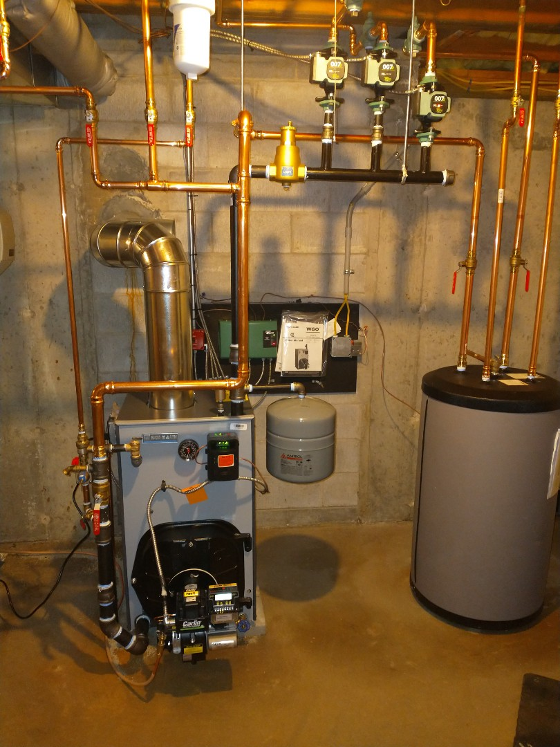 Berlin, CT - Installing a Weil McLain oil boiler with a Carlin burner and a 40 gallon heat flo indirect water heater.