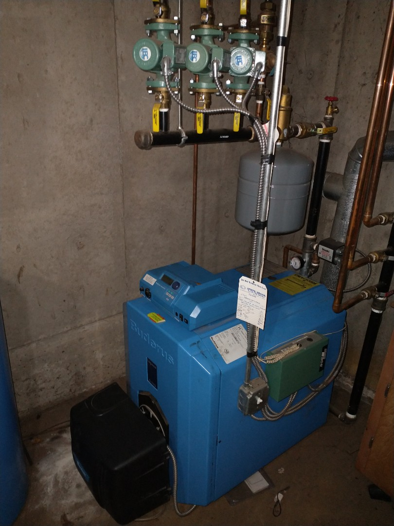 Berlin, CT - Performing annual maintenance on oil fired buderus boiler with a Beckett burner.