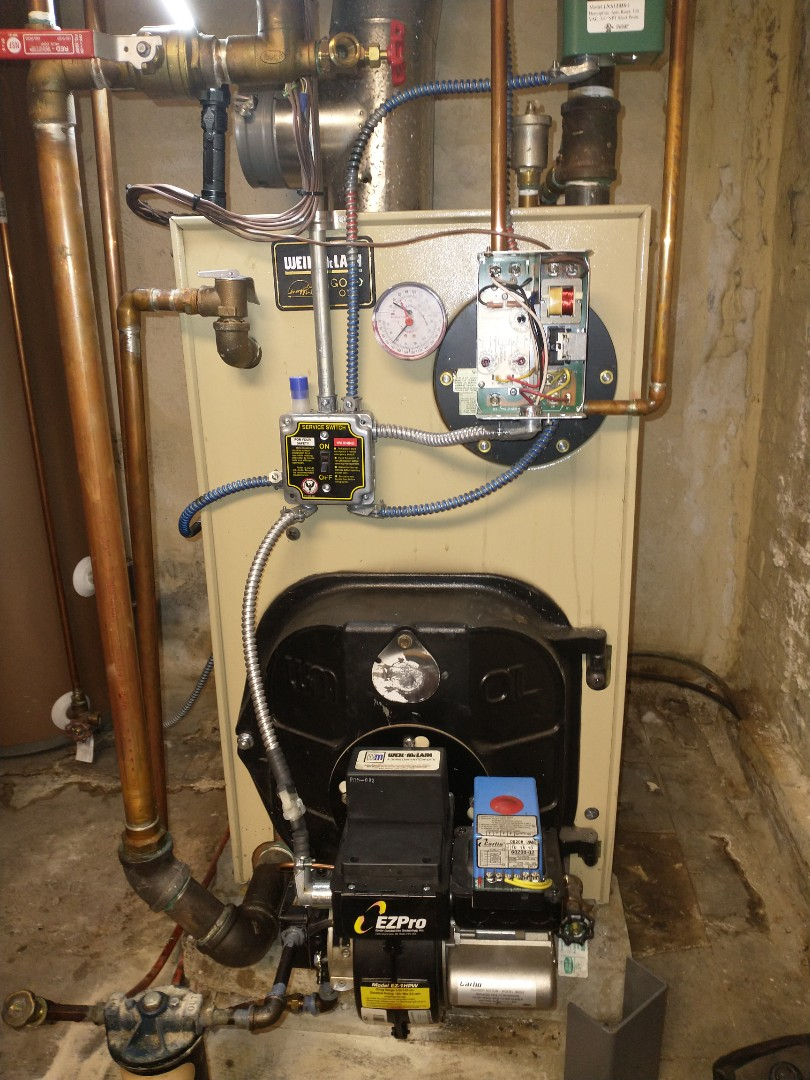 New Britain, CT - Performing annual maintenance on a Weil McLain oil boiler with a Carlin burner.