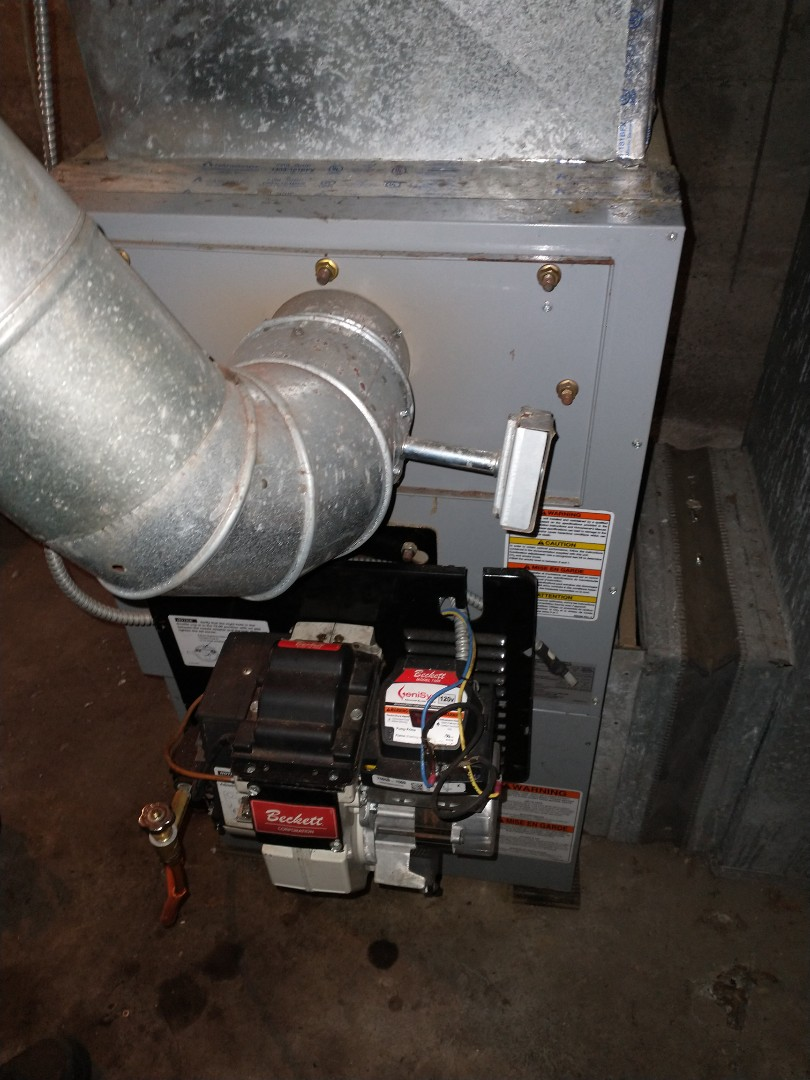 Berlin, CT - Performing annual maintenance on a Carrier oil furnace with a Beckett burner.
