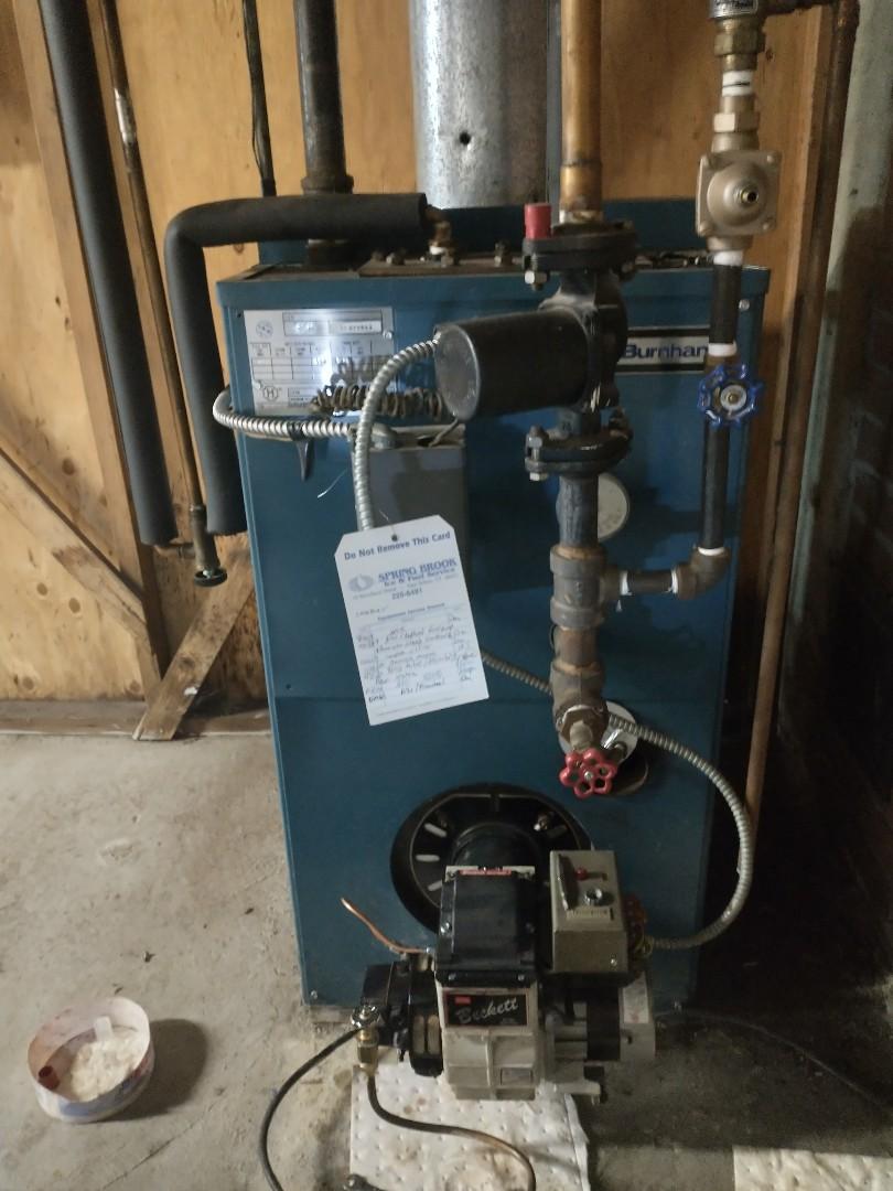 Farmington, CT - Performing annual maintenance on a Burnham oil boiler with a Beckett burner.