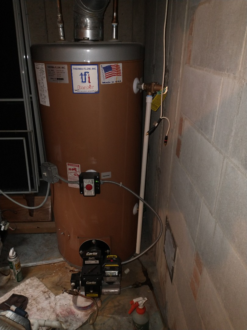 Farmington, CT - Performing annual maintenance on a 50 gallon oil fired water heater with a Carlin burner.