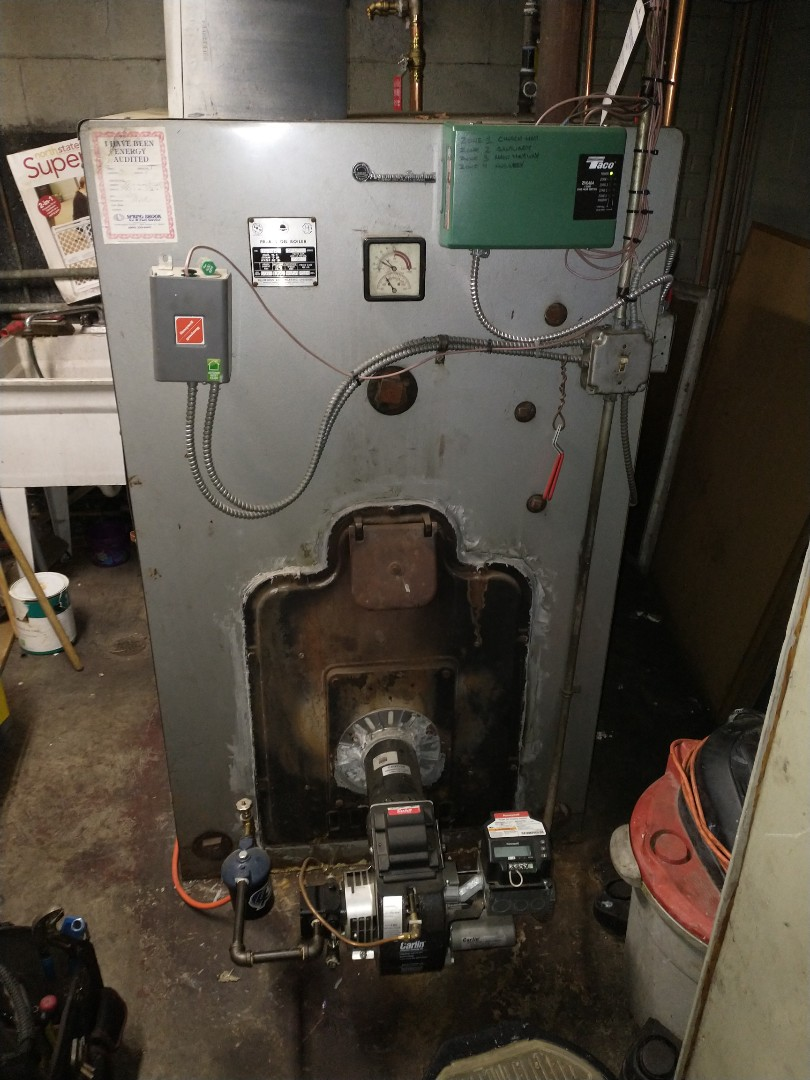 New Britain, CT - Performing annual maintenance on a American standard oil boiler with a Carlin burner.