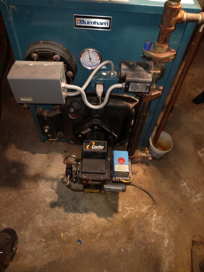 New Britain, CT - Performing annual maintenance on a Burnham oil boiler with a Carlin burner.