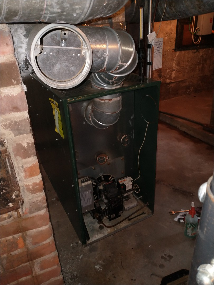 Berlin, CT - Performing annual maintenance on a williamson oil furnace with a Beckett burner.