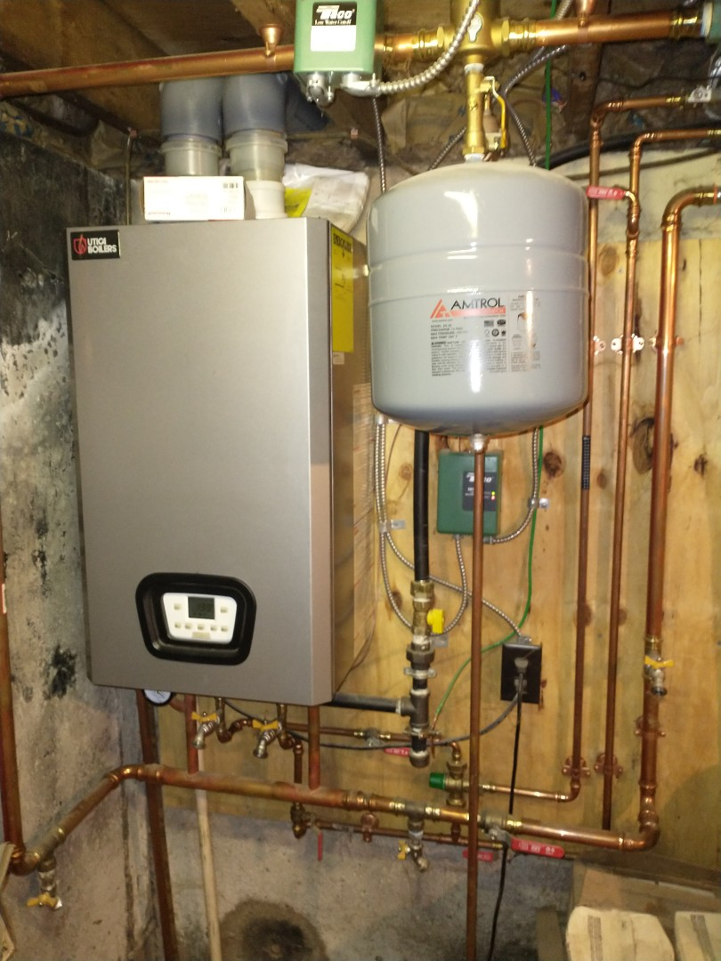 Bristol, CT - Performing annual maintenance on a high efficiency Utica natural gas boiler.