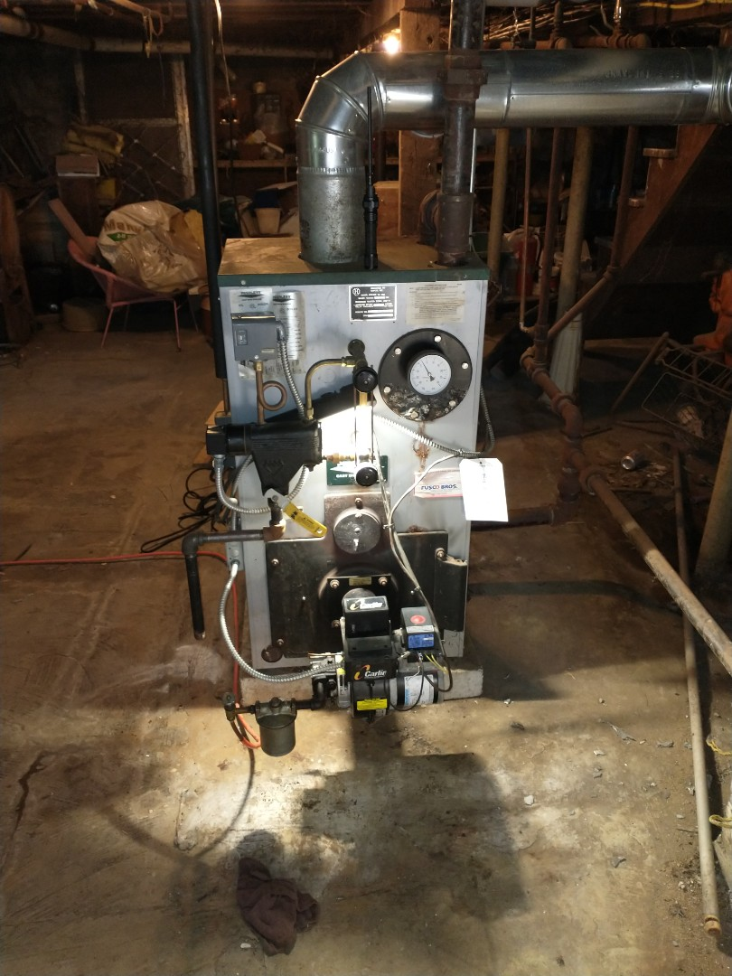 Newington, CT - Replacing a combustion chamber on a peerless oil boiler with a Carlin burner.