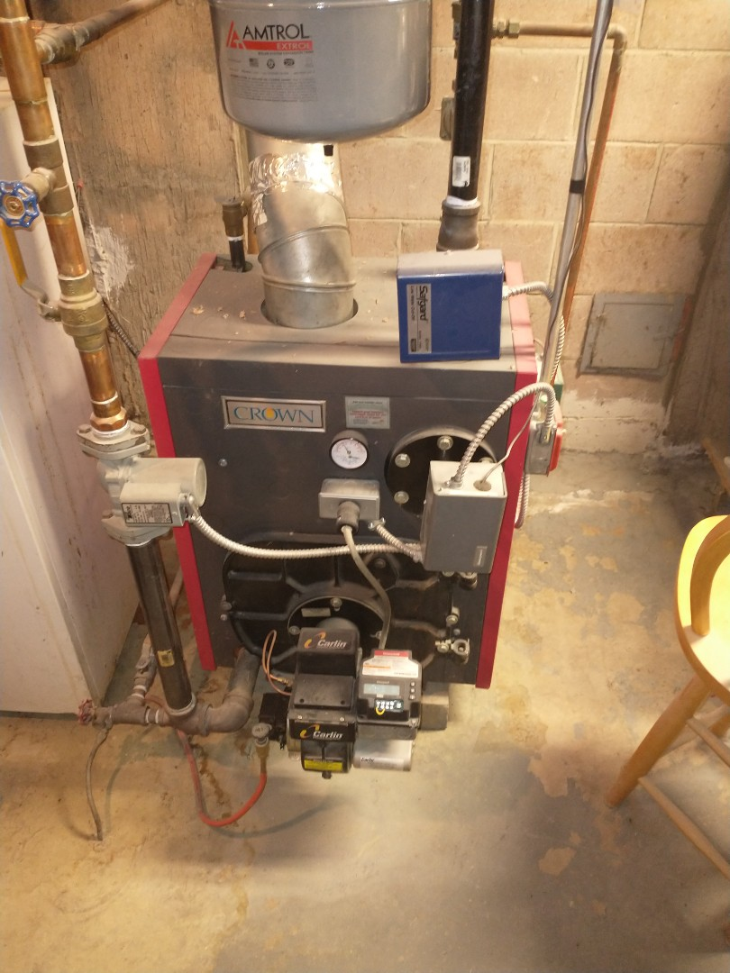 Berlin, CT - Performing annual maintenance on a crown oil boiler with a Carlin burner.