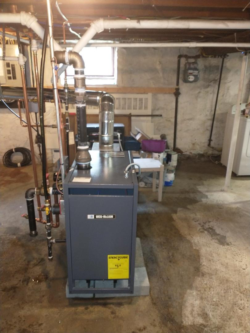 New Britain, CT - Installing a Weil McLain steam natural gas boiler.