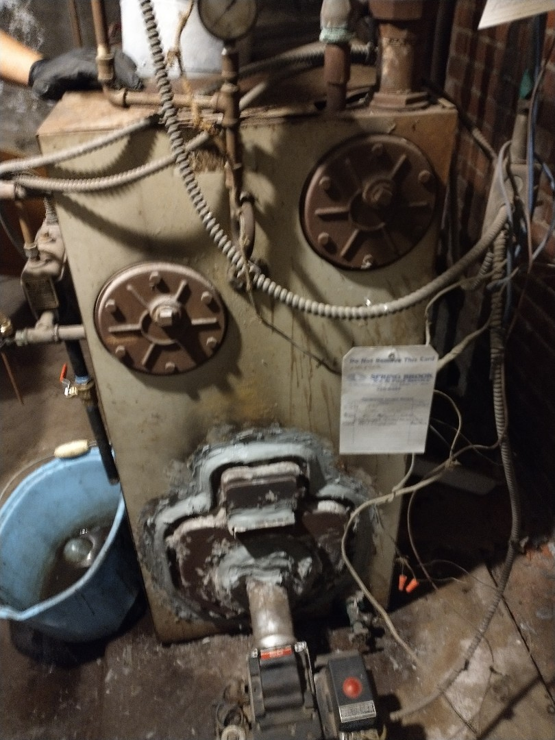 West Hartford, CT - Performing annual maintenance on a American standard steam boiler.