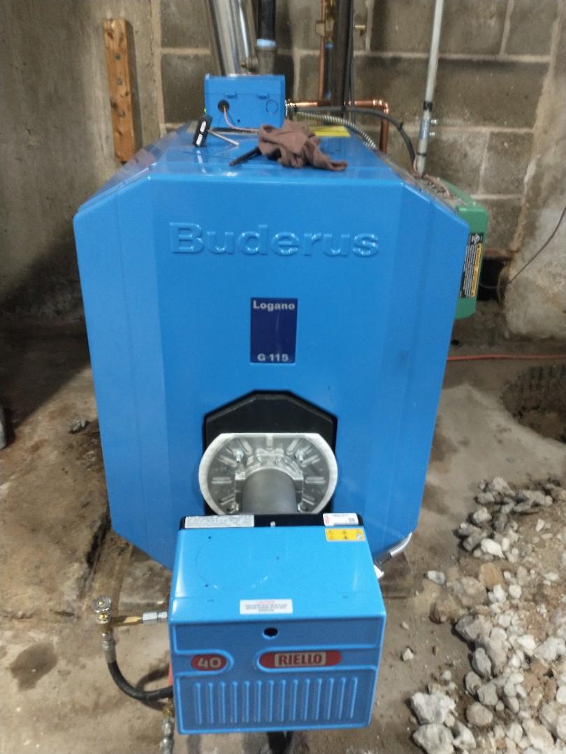 Farmington, CT - Performing annual maintenance on a Buderus oil boiler with a riello burner.