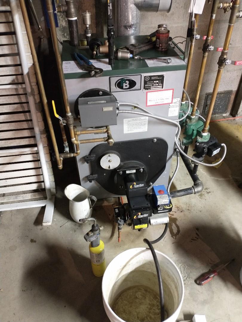 Repairing a water leak on a peerless oil boiler.