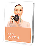 Picture of calm teenage girl with digital camera Presentation Folder