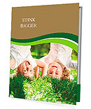 Happy children playing head over heels on green grass in spring park Presentation Folder