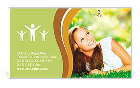 Spring Beauty Girl. Beautiful Young Woman Lying on Green Grass outdoor. Park. Meadow. Summer. Spring Business Card Template