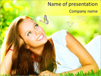 Spring Beauty Girl. Beautiful Young Woman Lying on Green Grass outdoor. Park. Meadow. Summer. Spring PowerPoint Template