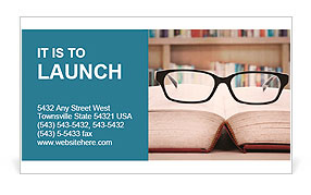 Closeup of reading glasses on the book. shot in the library Business Card Templates